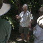 A photo of Alan Carle conducting a Botanical Ark Garden Tour to two couples