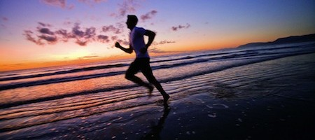 Early morning jog along Four Mile Beach, Port Douglas, Queensland, Australia