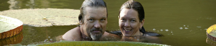 Alan and Susan Carle swimming in their water garden at The Botanical Ark